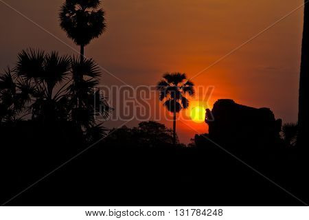 Sun Rising Behind Ruins Of Angkor Wat