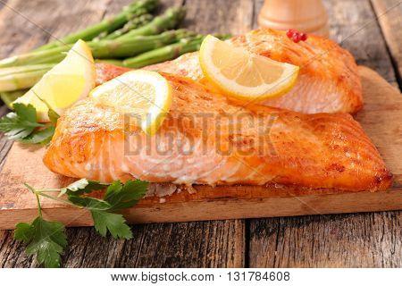 baked salmon fillet on board