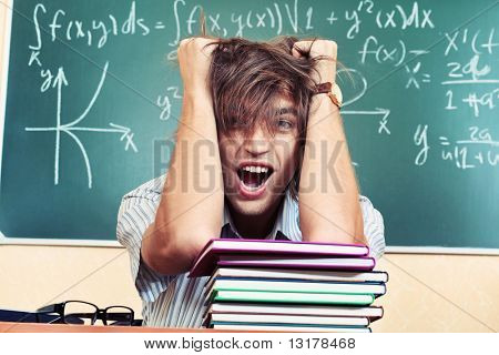 Educational theme: crazy male student in a classroom.