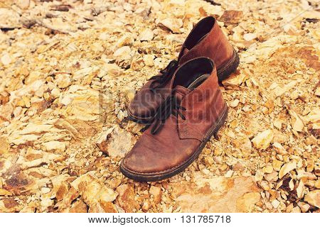 Vintage tone: Leather Shoe on Orange rocks