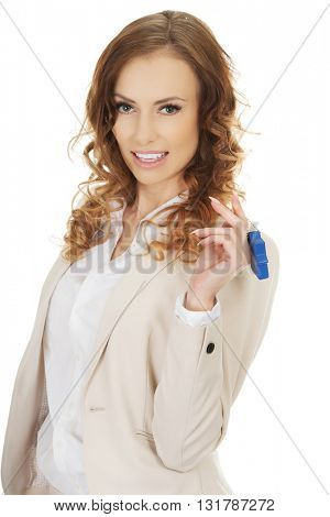 Real estate agent with house pendant.