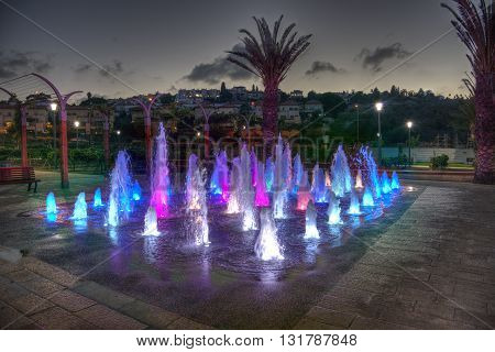 Zikhron Ya'akov, Israel, September 23, 2014 : kids playing in colored fountain at the playground