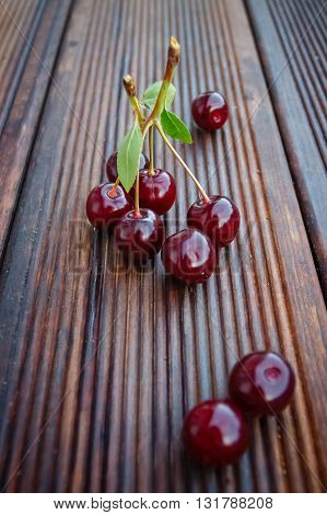 Sweet ripe cherry on wooden background on wooden background