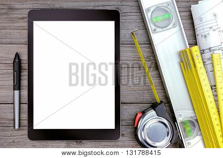 Digital Tablet Computer And Tools On Gray Wooden Table