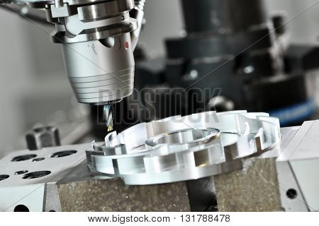 Milling cutting metalworking process. Precision industrial CNC machining of metal detail by mill at factory
