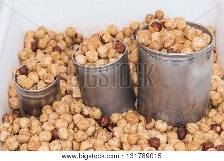 Street peasant food,Salted and dried pumpkin seeds, chickpeas, hazelnuts and roasted peanuts .