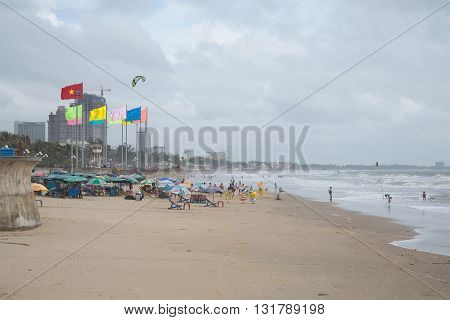 VUNG TAU, VIETNAM - DECEMBER 22, 2015: In the central city beach after a storm. The largest resort in Vung Tau, tourist ladmark the Vietnam