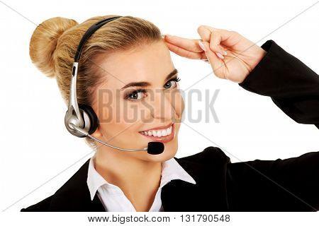 Salute young businesswoman in headphones