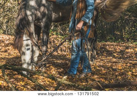 Detail Of A Girl Standing By Her Grey Horse