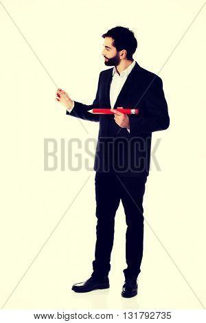 Intelligent man with big pencil.