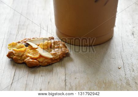 cereal cookie and ice coffee in plastic cup