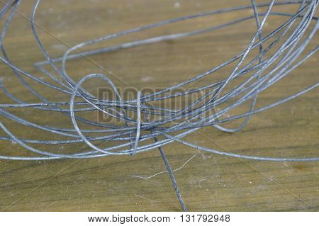 iron wire roll on the wooden table