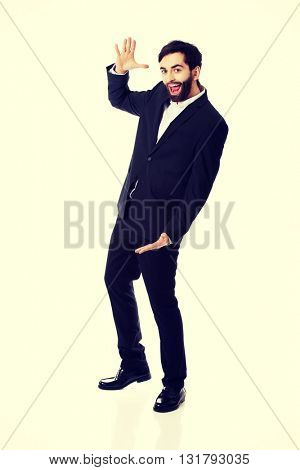 Young businessman presenting something in hands.