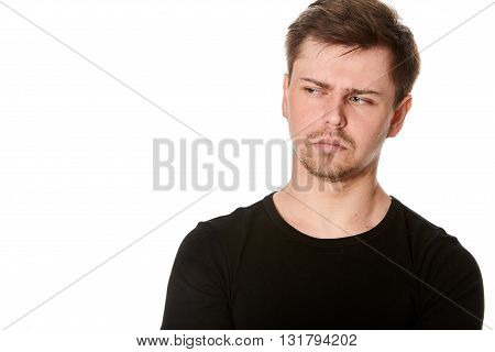 Suspicious young man isolated on white with space for text