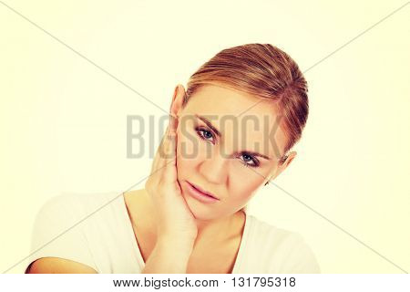 Young woman with tooth ache