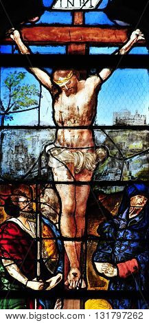 Triel sur Seine France - april 3 2016 : the Christ on historical stained glass window in Saint Martin church