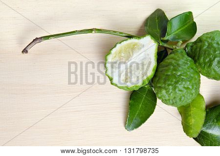 Bergamots (Other names are Kaffir lime Citrus Magnoliophyta Rutaceae) fruits with leaf