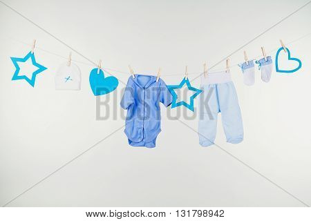 Colorful child boy clothes set isolated on white. Collage of male kid clothing on white background.