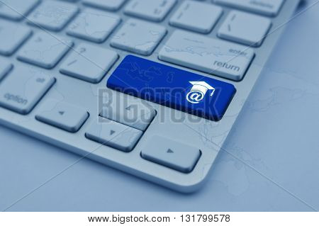 E-learning icon on modern computer keyboard button with world map Study online concept blue tone Elements of this image furnished by NASA
