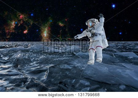 The astronaut on the unknown planet has found the frozen ocean of water. Elements of this image furnished by NASA. Collage.