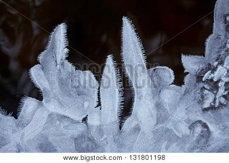 Blue water ice crystals and black water