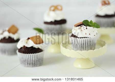 Chocolate cupcakes on a white wooden table
