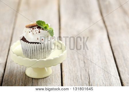 Chocolate Cupcakes On Stand On A Grey Wooden Table