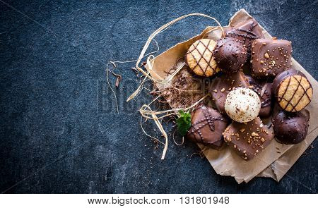 Assortment of chocholate biscuits on rustic background