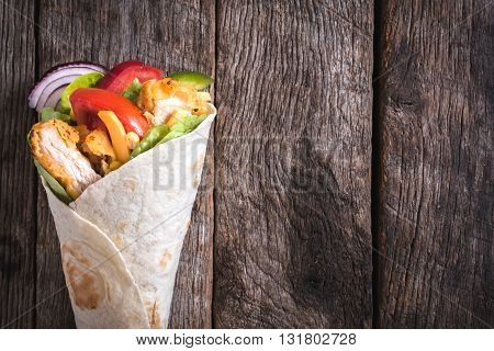 Photos of chicken wrap on rustic background