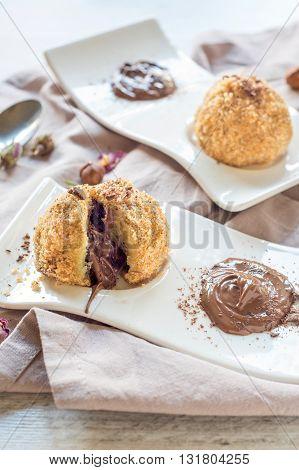 Nougat cream in dumplings on rustic background
