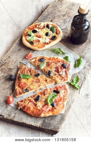 Photos of served vegetarian pizza on rustic background