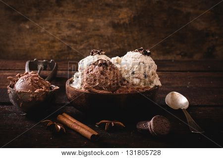 Photos of sweet ice cream on rustic background
