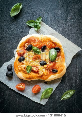 Photos of vegetarian mini pizza on rustic background