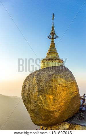 Kyaikhto,  Myanmar - January 10, 2012:  The delicately balanced golden Stupa on the sacred Buddhist mountain