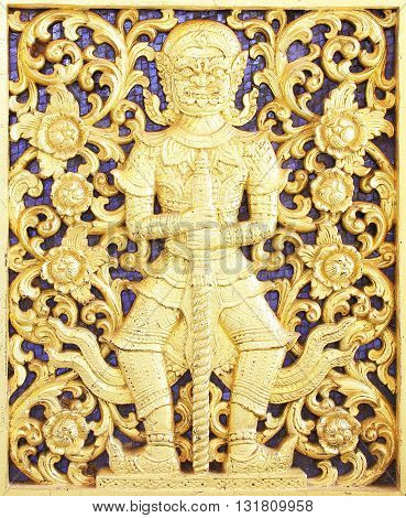 Ancient golden carving wooden window of Thai temple ; Vintage Thai style wood craft