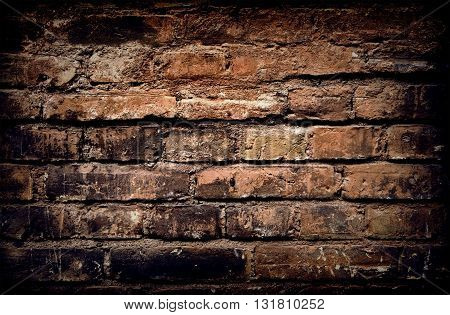 Old brick wall, aged brick background or texture, rough brick wall
