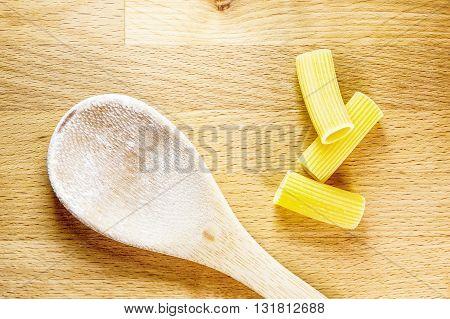 Raw Dried Pasta On Cutting Board