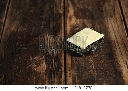 Slice Of Black Charcoal Luxury Homemade Bread With Butter Isolated On Rustic Wooden Table, Rich Text
