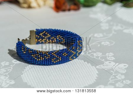 Beaded Crocheted Bracelet With Oriental Ornaments Blue With Golden