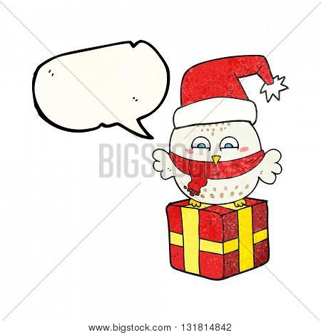 freehand speech bubble textured cartoon cute christmas owl on wrapped present