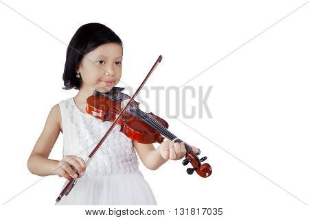 Portrait of a little girl playing violin in the studio isolated on white background