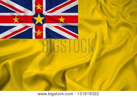 Waving Flag of Niue, with beautiful satin background