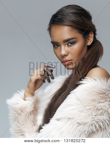 young beauty african american mulatto sensual woman with fashion make up, emotional face closeup