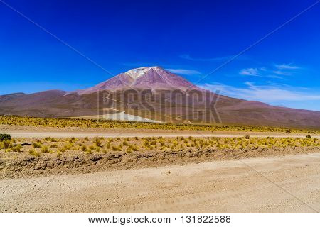 View of crater of domant volcano and glacier at Uyuni in Bolivia