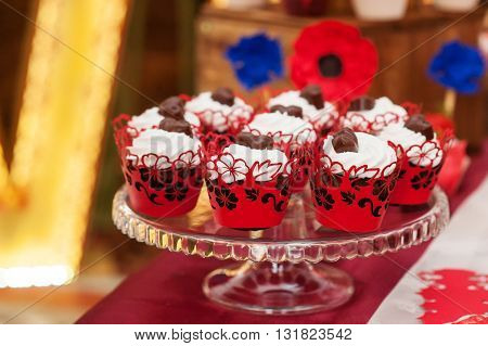decorated set of cupcakes or fairy cake for wedding on table.