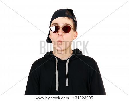 Teenager in the Cap and Sunglasses Isolated on the White Background