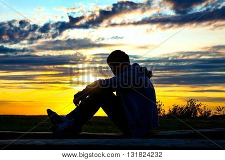 The Person Silhouette at the Sunset Background