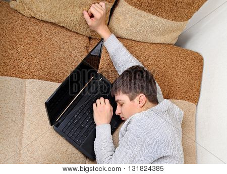 Tired Teenager sleep on the Laptop at the Home