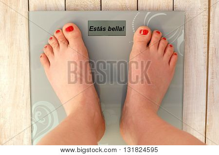 Feet On Scales With Text You Are Beautiful In Spanish Language