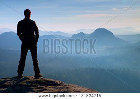 Hiker On Sandstone Rock In Rock Empires Park And Watching Over The Misty And Foggy Morning